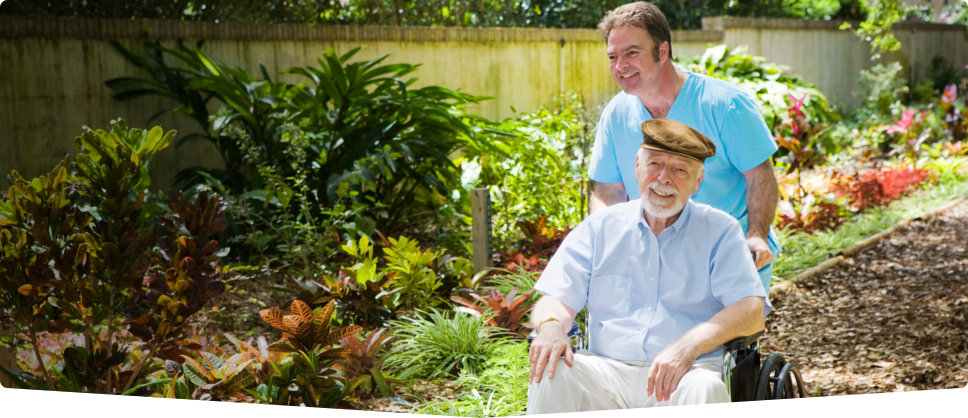 caregiver and an old man on the garden